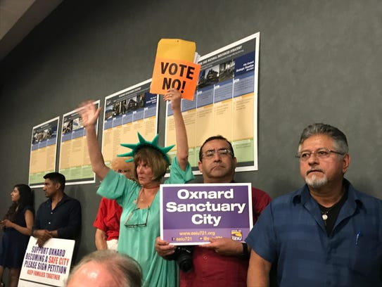 Supporters and opponents of a safe city resolution