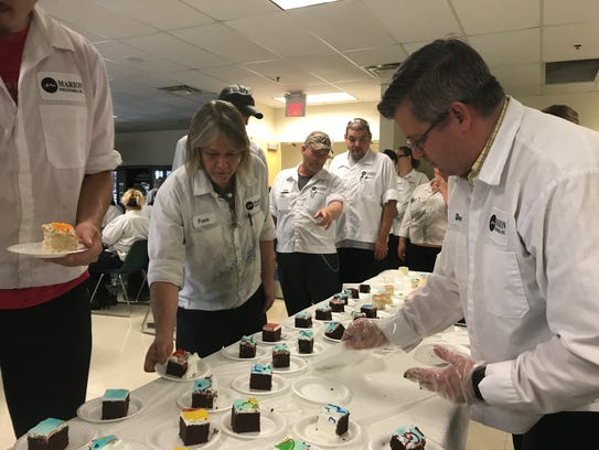 Employees at Marion Industries celebrated with cake