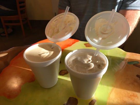 A peanut butter milkshake (left) and a coffee milkshake