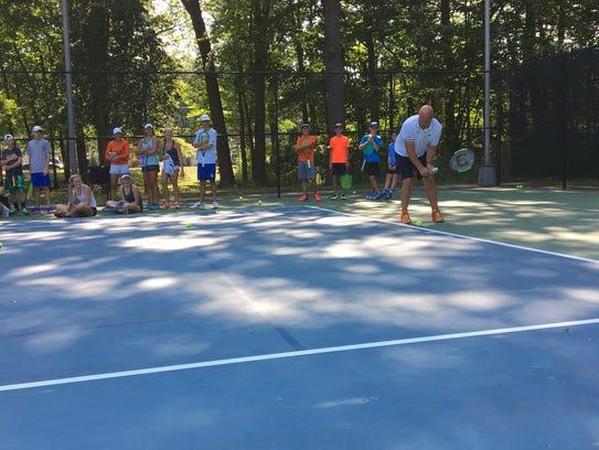 Former professional tennis player Luke Jensen has fun