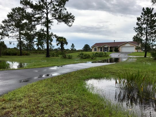 Attached are photos of water remaining in ditches and
