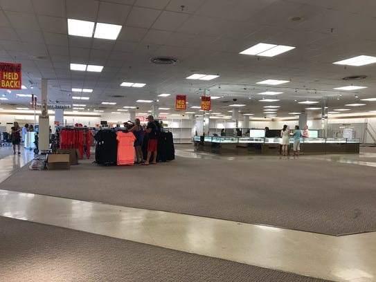 About 20 customers look through the remaining items