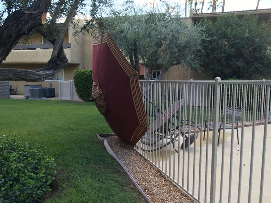 Pool furniture is on its side at a Palm Springs condo