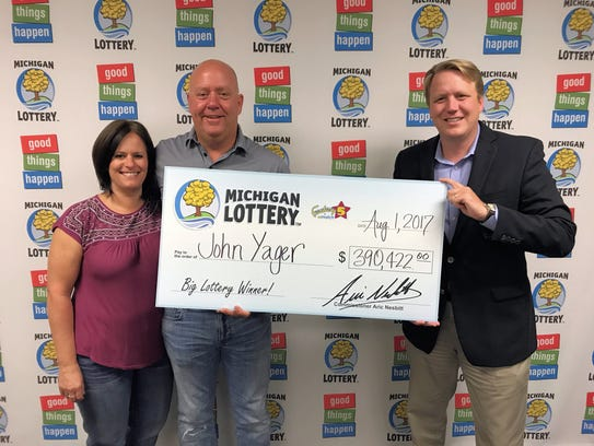 Lottery Commissioner, Aric Nesbitt, presents John Yager