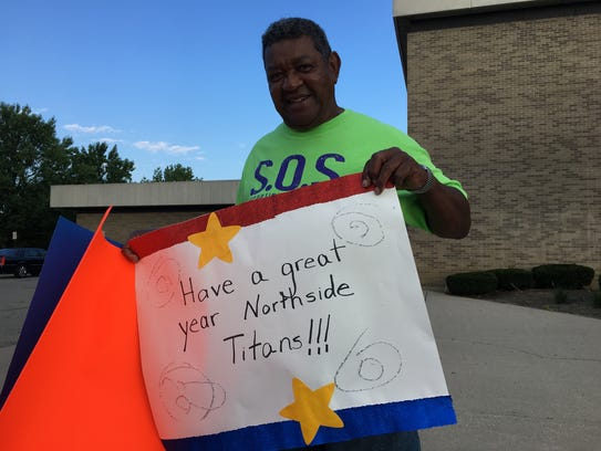 Cornelius Dollison greets students at Northside Middle