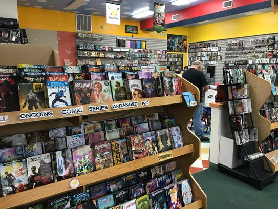 The comic racks at Dragon's Den, now located at 939
