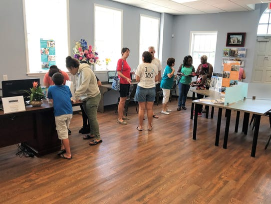 Attendees learn about the technology and library services