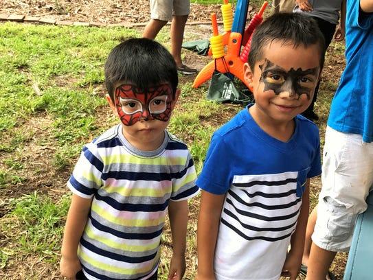 Neighborhood children show off their favorite superhero