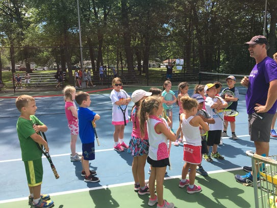Port Huron Tennis House instructor Dave Brown brings