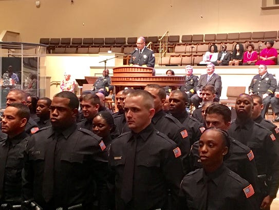 Police academy graduates faced family and friends during