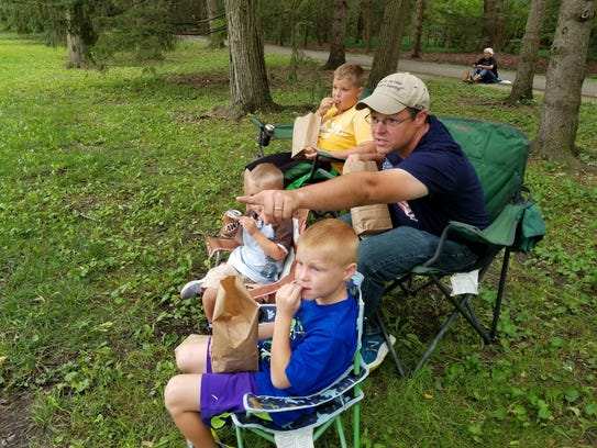 Tom Waldsmith and sons Joseph, 9, far, Aaron, 3, middle