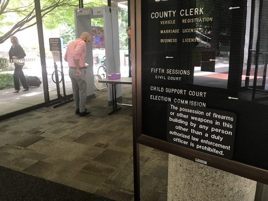 A man goes through the metal detectors inside Knoxville's