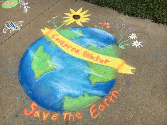 Chalk art decorates the walkways at the Okoboji Blue