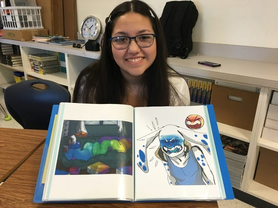 Irvin High art student Kaelyn Monarrez holds up some