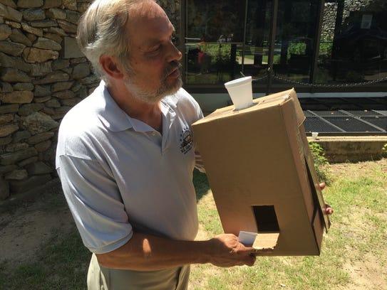W.A. Gayle Planetarium Director Rick Evans with a homemade