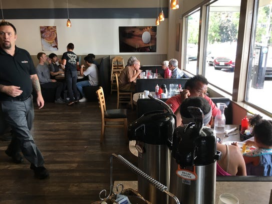 Diners enjoy lunch inside the Sassy Onion.