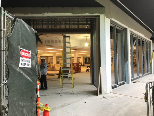 Workers preparing the new Century 21 store at the Mall