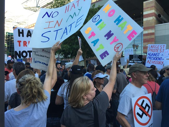 Protesters milled about, waving signs and chanting,