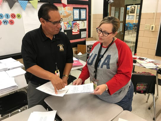 Michael Garcia, principal at Abilene High School, reviews