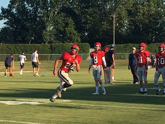 Decatur High School star practicing to field punts