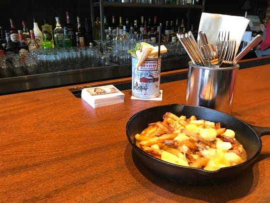 The classic poutine, combining fries, cheese curds