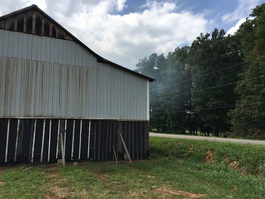 Smoke escapes from this barn on Jason Barnett's farm