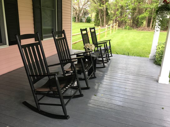 Rocking chairs line the porch of the Pleasant Valley