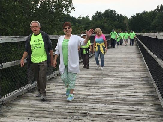 Participants cross the Mill Creek trestle at Monday's