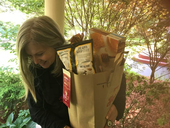 Amy Jerman of Hart's arrives with groceries.