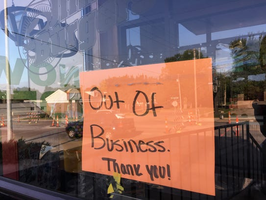 "The ""out of business"" sign on the front door of Jim's"