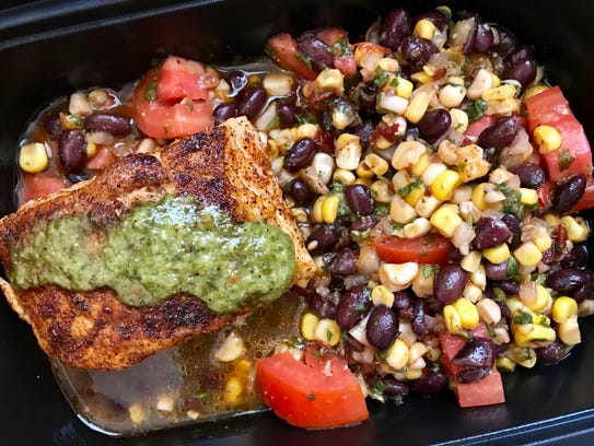Salmon with chimichurri sauce with black beans, corn