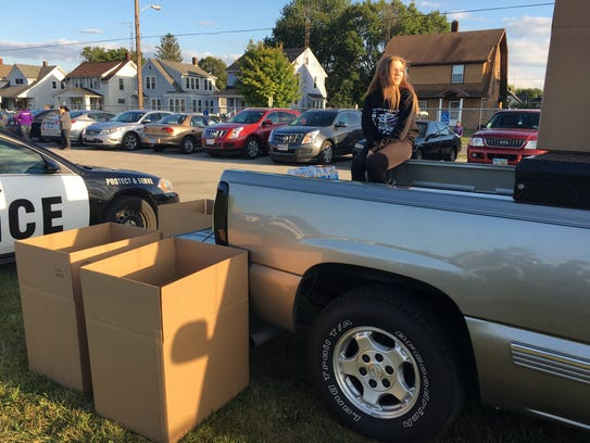 Senior Charlotte Whitney collects items for victims