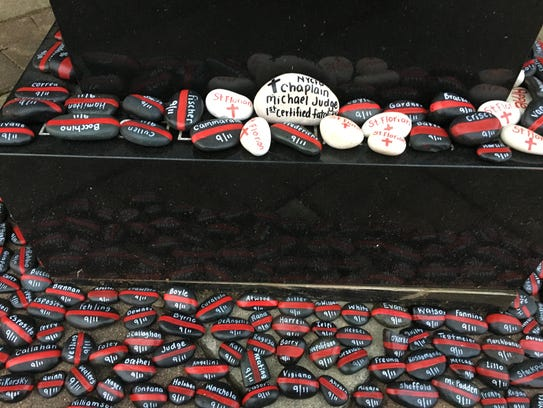 Tavia Bloom painted 343 rocks, one for each firefighter