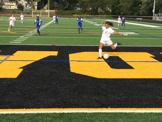 Cedar Grove sophomore Jamie Dente takes a shot on goal
