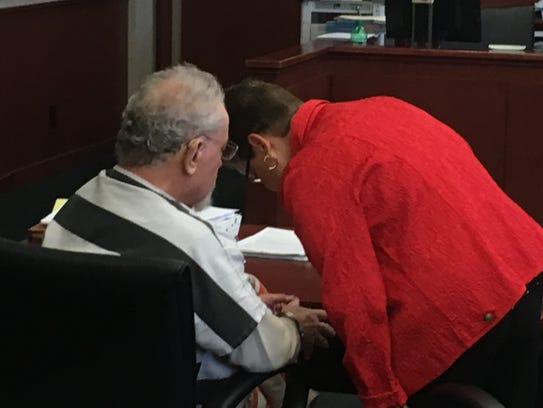 Tim Nolan confers with his attorney Margo Grubbs in