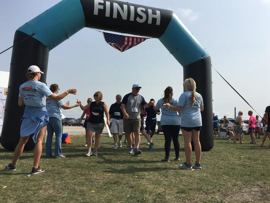 Runners and walkers take a beer upon finishing the