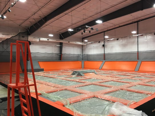 The main trampoline area, covered by temporary protective