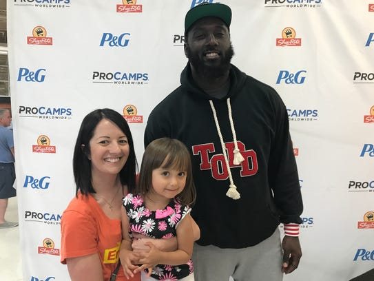 New York Jets star Mo Wilkerson greets a young fan