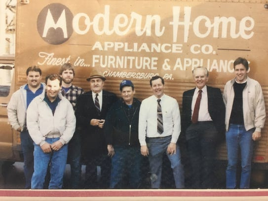 Modern Home Appliance partners and employees circa