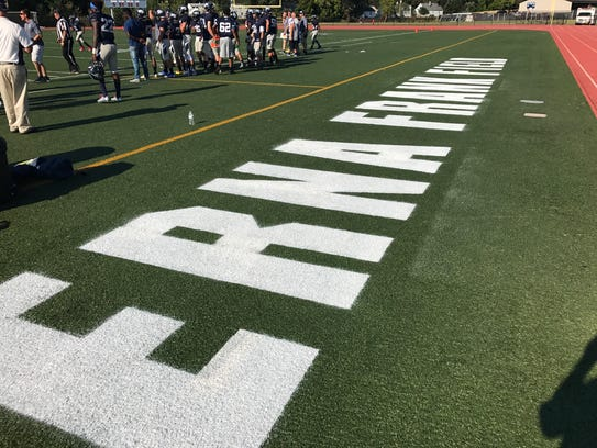 Markings on the turf field dedicated in the name of
