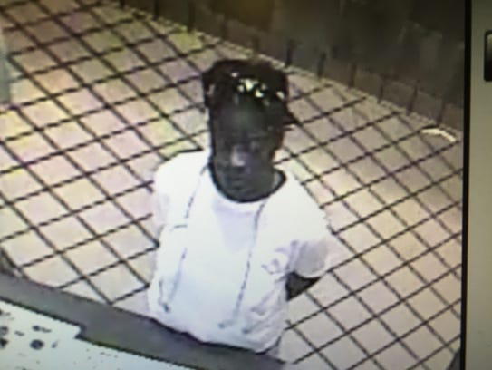Surveillance photo of a suspect in the robbery of a