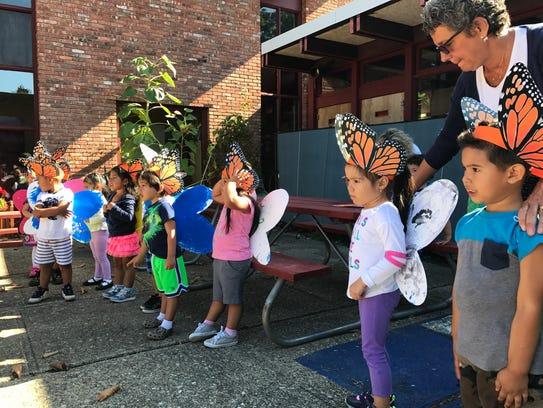 Preschool students at Project Head Start dress as monarch