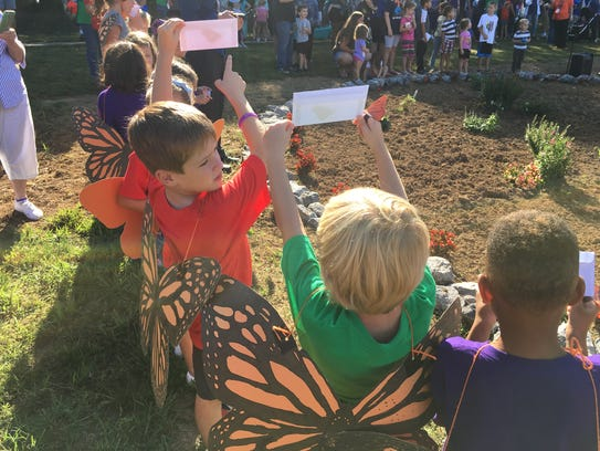 Students from Union Elementary School prepare to launch their butterflies at the Monarch in the Park event earlier this year.