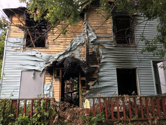 A burned-out house at 707 N. Mulberry St. is in the