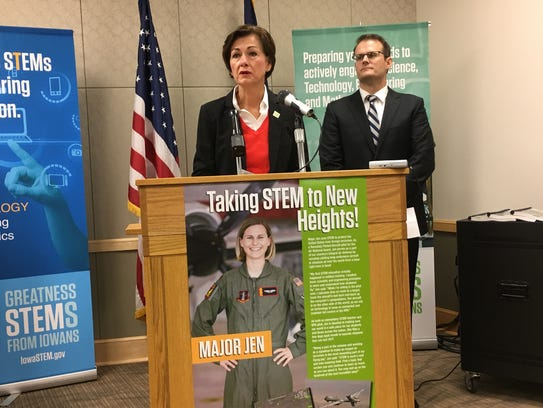 Gov. Kim Reynolds holds a news conference with acting