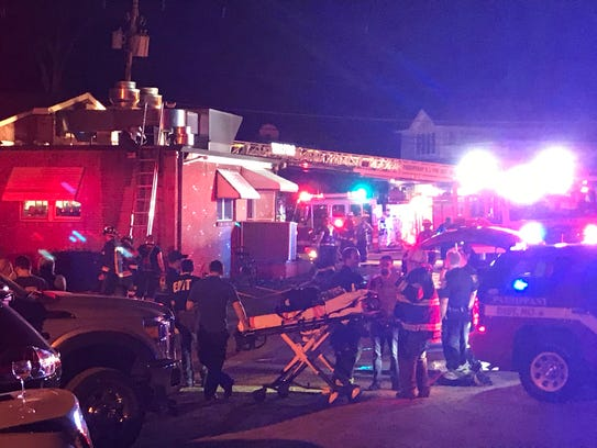 Firefighters on the scene of a fire at the historic