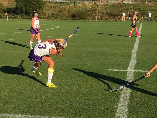 St. Rose senior Lauren Denci sends a ball down the