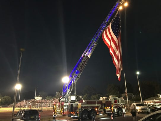 A flag hangs from a Lincoln Park Fire Department ladder
