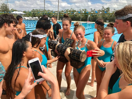 Swimmers from the Gulf Coast swim team pose for selfies