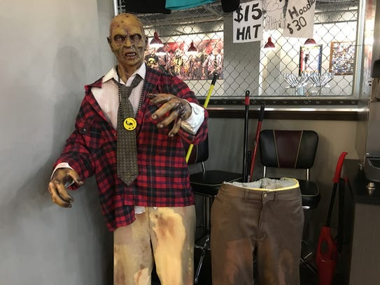 Harry and Debbie, pictured here missing from the waist up, are two life-sized zombies at Zombie Burger's Iowa City location. Debbie's stolen torso was returned on Saturday.